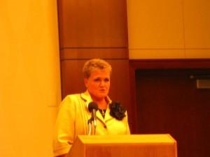 Cathy at the Podium